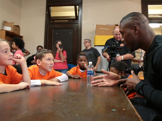 Cincinnati Bengals defensive end Carlos Dunlap visits the Sarah Heinz House, a member of the Boys & Girls Clubs of America, a stop on Dunlap's Literacy Campaign to tacklebullying one AFC city at a time, Saturday, Oct. 21, 2017, in Pittsburgh.