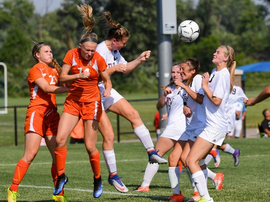 Ames' Lorelle Kraus (14) and Michaela Twito (21) defend