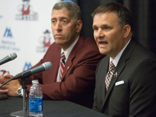 Chris Jans, right, speaks on April 17, 2017 during a press conference in the Barbara Hubbard Room at NMSU where he is announced as the new NMSU men's basketball coach. Seated beside Jans is NMSU athletic director Mario Moccia.