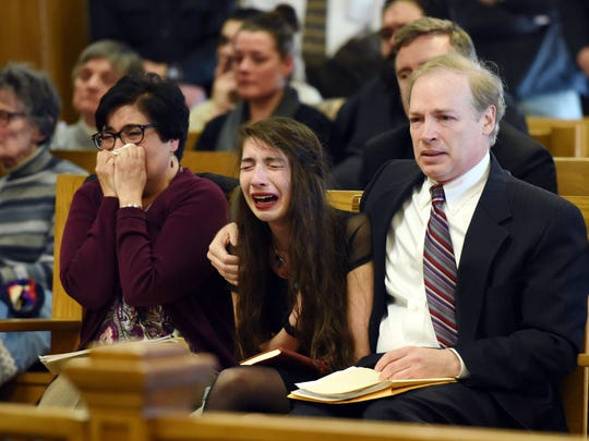 The parents and sister of Sarah McCausland, from left, Sandra McCausland, Victoria McCausland, 17, and Andrew McCausland, react during the sentencing of Carol Boeck on Tuesday in Dutchess County Court in the City of Poughkeepsie. Carol Boeck was sentenced by Judge Stephen Greller for the hit-and-run death of Bard College students Sarah McCausland and Evelina Brown.