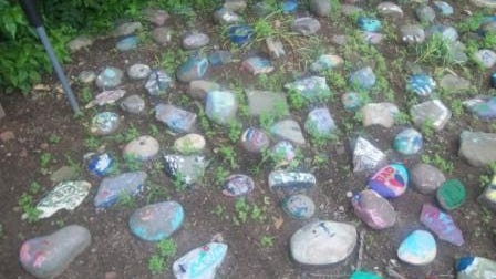 Rocks were painted by children in memory of a loved on during the annual Memorial Rock Garden Ceremony at United Hospice of Rockland on Wednesday night.