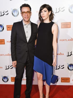 Fred Armisen, left and Carrie Brownstein, right arrive at Portlandia Season 5 Premiere Presented by Bulleit Bourbon at The Theatre at Ace Hotel on Monday, Jan. 5, 2015, in Los Angeles, CA. (Photo by Rob Latour/Invision/AP)