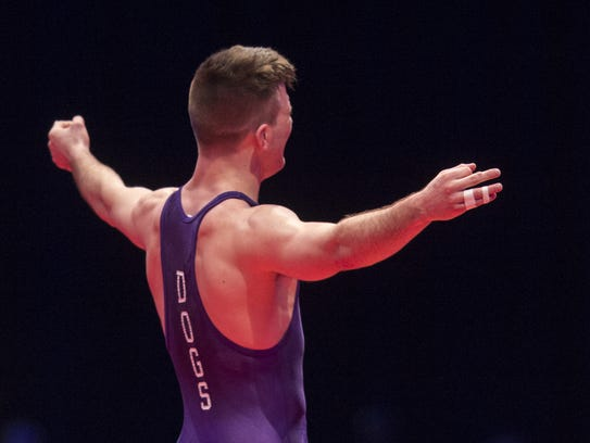 Brownsburg High School's Brayton Lee reacts after defeating