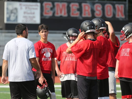 Emerson head coach Nick Calandrino talks with his offense.
