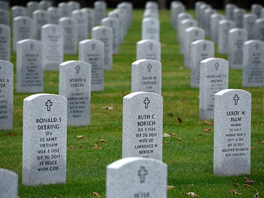 Grave markers are lined up in perfect rows at the Minnesota