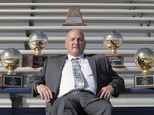 The boy's coach of the year is Del Valle's Bruce Reichman.