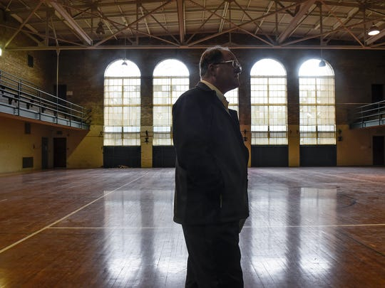 In this October 2017 file photo, St. Cloud State University assistant vice president for facilities management Phillip Moessner talks about renovation plans in the gymnasium of Eastman Hall during a tour.