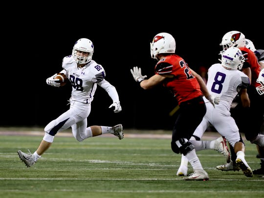 Shasta's James Weaver carries the ball Saturday during