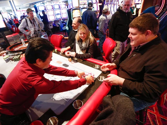 Tom Lynch of Newburgh, right, pulls in some winnings on the roulette table at Resorts World Catskill Casino in Monticello in February.
