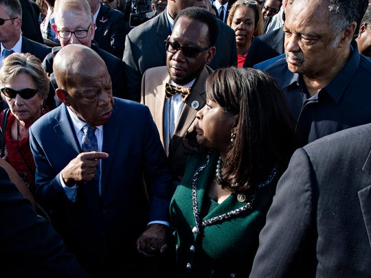 From left, Congressman John Lewis speaks to Congresswoman Terri Sewell as Rev. Jesse Jackson looks on while they walk across the Edmund Pettus bridge during the Bridge Crossing Jubilee in commemoration of the 53rd anniversary of Bloody Sunday on Sunday, March 4, 2018, in Selma, Ala.