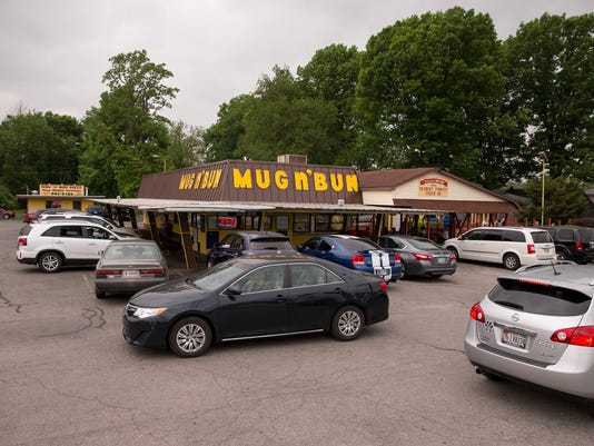 Situated about a mile from the Indianapolis Motor Speedway, Mug-n-Bun runs at full tilt during Indy 500 week, but shuts down during race Sunday, as the streets near it are blocked. The business, which serves many of the dishes you would see at the State Fair, has been going since 1960, and uses car hops to take orders and deliver items on a window-mounted trays. A separate picnic area and building exists for people who don't have an auto, or choose to not eat in their car.