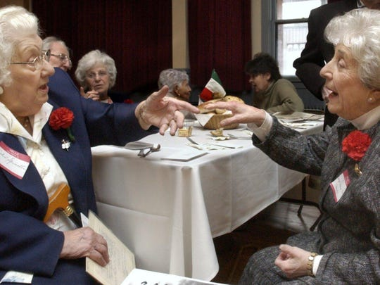 On May 1, 2005, Nelia Spinelli, left, of Barre and Nelda Rossi of Berlin talk during a May Day lunch at the Old Labor Hall in Barre. Both women have ancestors in a 1905 photograph of a group of Italian men who gathered on May Day in Barre 100 years ago.