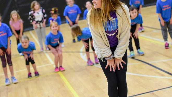 Rmette Jordy Butler instructs her group on Saturday, March 5, 2016, during the RhythAMettS pom clinic at Southeast Polk High School.