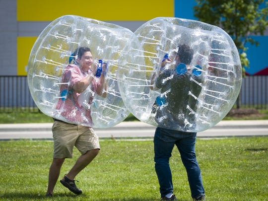 Father and son Benjamin Passey, Noblesville, left, and Richard Passy, Indianapolis, collide off one another as they play in bubble balls at the event. The inaugural Flow Fest – an arts and cultural festival – took place Saturday, July 9, 2016 at Historic Central State Mansion. The event featured a day full of music, theatre, dance, visual arts, magic, clowns, bubbles, balloons, yoga, food, beer, and celebration of the many cultures that make up Indy's near west side.