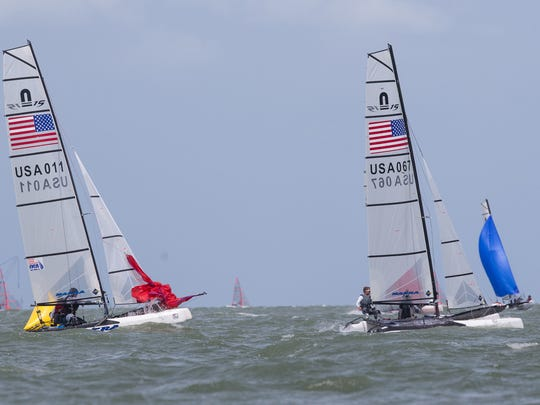 Sailors race in Corpus Christi Bay during the second day of the U.S. Sailing 2017 U.S. Youth Championships on Monday, June 26, 2017.