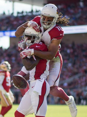 November 5, 2017; Santa Clara, CA, USA; Arizona Cardinals wide receiver Jaron Brown (13) is congratulated by wide receiver Larry Fitzgerald (11) for scoring a touchdown against the San Francisco 49ers during the first quarter at Levi's Stadium. Mandatory Credit: Kyle Terada-USA TODAY Sports