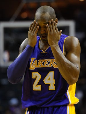 Lakers guard Kobe Bryant is out for about six weeks after injuring his left knee against the Grizzlies on Tuesday.