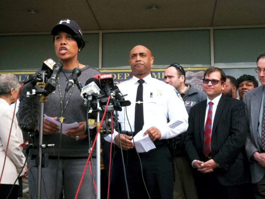 Baltimore Mayor Stephanie Rawlings-Blake, left, speaks at a news conference about the situation in Baltimore Tuesday with Baltimore's Police Commissioner Anthony Batts, center. Baltimore was a city on edge as hundreds of National Guardsmen patrolled the streets against unrest for the first time since 1968, hoping to prevent another outbreak of rioting.