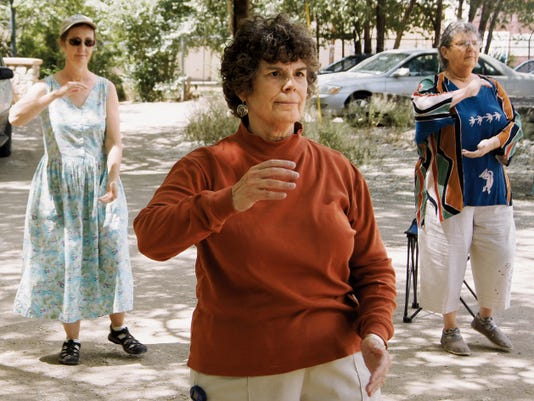 Tai Chi instuctor Liz Mikols, center, leads students Nancy Evey and Sarah Bohannon through the Tai Chi: Moving for Better Balance form on Thursday in Silver City. The group meets at 11 a.m. on Mondays and Thursdays by the Big Ditch downtown just off 7th Street. Classes are 2 with the first class free. Randal Seyler - Sun-News