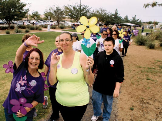Bill Armendariz - Headlight Photo   Members of the Willow Manor Assisted Living Team, Beverly Fiorentino, left, and Melissa Kern, show their joy and support during the Walk to End Alzheimer's held Saturday morning at Voiers Park. The walk was organized by staff at Mimbres Memorial Hospital and the New Mexico Alzheimer's Association. Deming is one of six New Mexico cities that organized a walk to raise awareness and money.