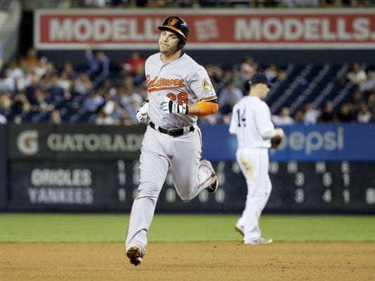 Baltimore's Steve Pearce (28) runs past New York's Stephen Drew on his way to home plate after hitting a home run during the eighth inning on Wednesday in New York.