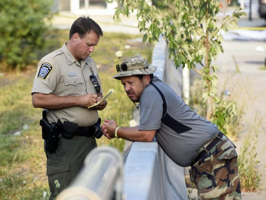 A waterways conservation officer takes a staement from Jim Keep, right, while investigating the fuel leak's effect on the Conococheague on Tuesday, July 28, 2015. Ryan Blackwell - Public Opinion