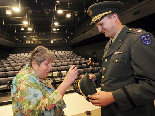 """Bobbi Simmons, of York City, feels the arrow that is in the prop hat of Tim Storey, an actor from DreamWrights Youth and Family Theatre. Simmons and her husband Rodger participated in a behind the scenes """"Touch Tour"""" for the visually impaired. Jason Plotkin - Daily Record/Sunday News"""