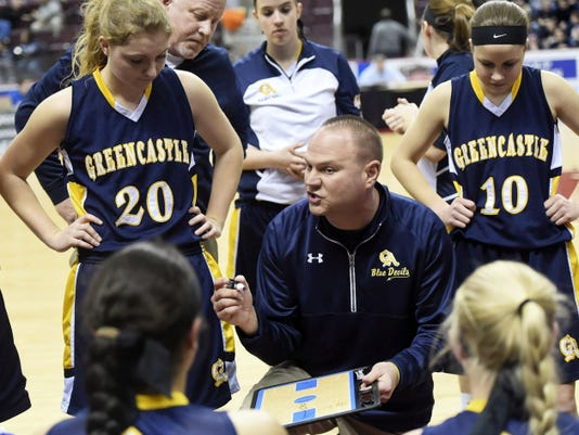 RYAN BLACKWELL — GAMETIMEPA.COM Greencastle-Antrim girls basketball coach Mike Rhine talks strategy with his team against West York during the District 3 Class AAA girls basketball semifinal Wednesday at Giant Center.