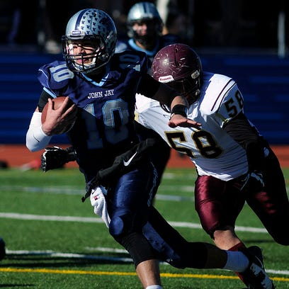 Our Lady of Lourdes quarterback Dean Rotger looks to pass during the Section 1 Class B championship game against Nanuet on Nov. 1, 2014 at Mahopac High School. Lourdes won,18-14.