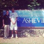 Manual's Dwayne Sutton, with UNC-Asheville coach Nick McDevitt