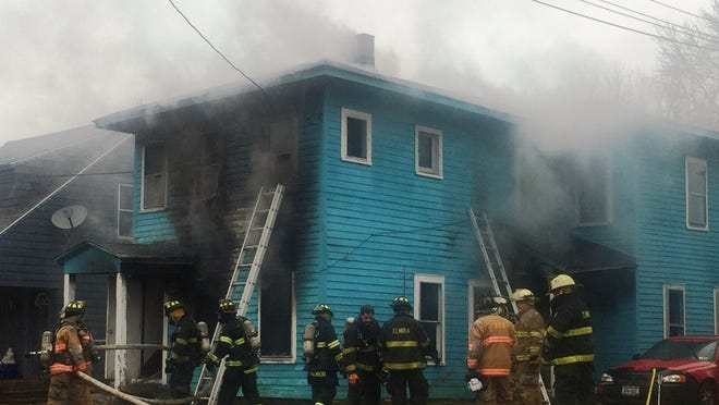 Elmira and Southport firefighters battle a blaze Wednesday morning at 307 West Ave. on the city's Southside.