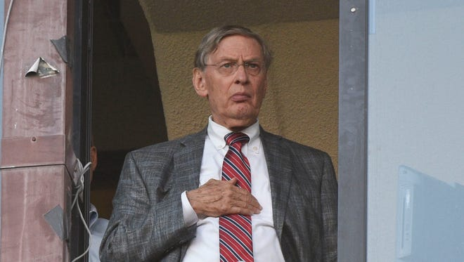 August 19, 2014; Oakland, CA, USA; MLB commissioner Bud Selig stands for the national anthem before the game between the Oakland Athletics and the New York Mets at O.co Coliseum. Mandatory Credit: Kyle Terada-USA TODAY Sports