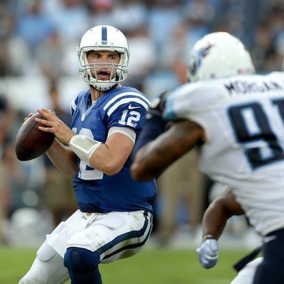 Indianapolis Colts quarterback Andrew Luck (12) drops