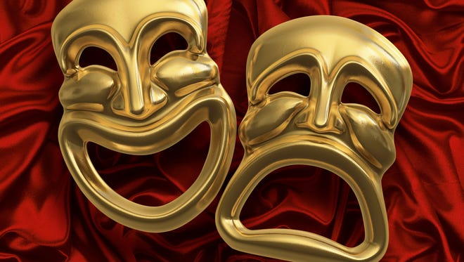 Classic comedy-tragedy theater masks against red curtain fabric