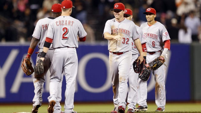 The Reds celebrate a 3-1 victory over the Giants on Wednesday.