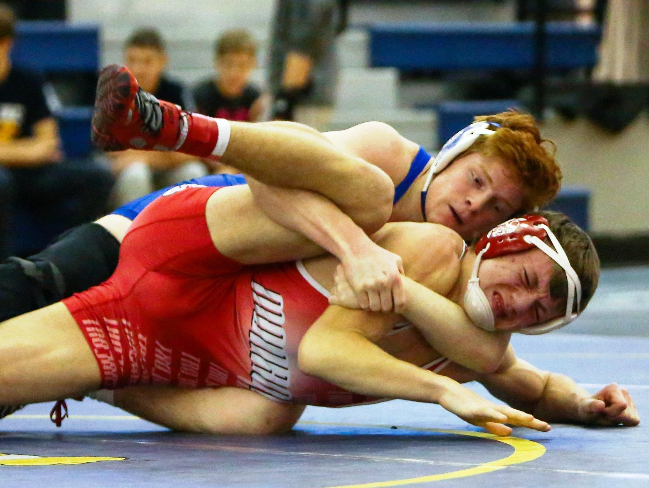 Catholic Central's Tyler Morland (top) took third-place honors last year at the Division 1 individual state finals.