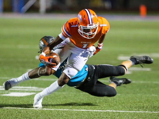 Central's Jesse Scott is tackled after a catch against El Paso Pebble Hills during their Class 6A Division II bidistrict playoff game Friday, Nov. 17, 2017, at San Angelo Stadium.