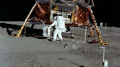 Neil Armstrong takes pictures of Buzz Aldrin during