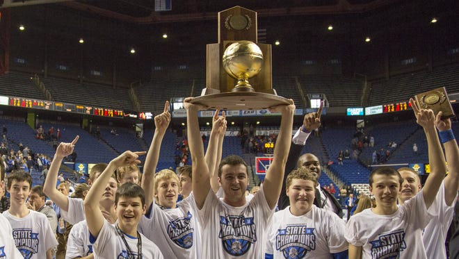 Covington Catholic wins over Scott County 59-51 in overtime to win the state championship  Sunday.