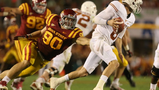 Iowa State defensive lineman Mitchell Meyers (90) chases Texas quarterback Case McCoy on Oct. 3, 2013.