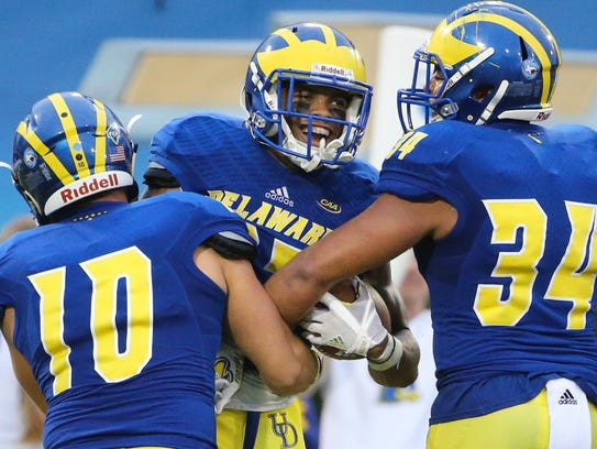 Delaware's Nasir Adderley celebrates his recovery of