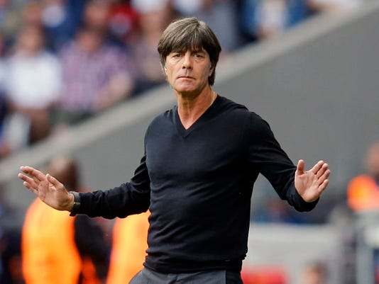 """FILE - In this Sunday, June 26, 2016 file photo, Germany coach Joachim Loew gestures during the Euro 2016 round of 16 soccer match between Germany and Slovakia, at the Pierre Mauroy stadium in Villeneuve d'Ascq, near Lille, France. The Confederations Cup soccer tournament might have some fans around the world. If so, they should enjoy this one in Russia while they can. FIFA's eight-nation World Cup rehearsal for the host country, six continental champions and World Cup title-holder is no sure thing to survive for another edition. """"If there was no Confed Cup in 2021, I wouldn't be unhappy,"""" Germany coach Joachim Loew said last month, naming a squad for Russia with only three of his 2014 World Cup players. """"I don't think those involved would be unhappy either."""" (AP Photo/Michael Probst, file)"""