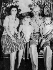 A portrait of Clayton Compher and his wife Mildred with their two oldest children Terry and Steve taken during Clayton's time in service.