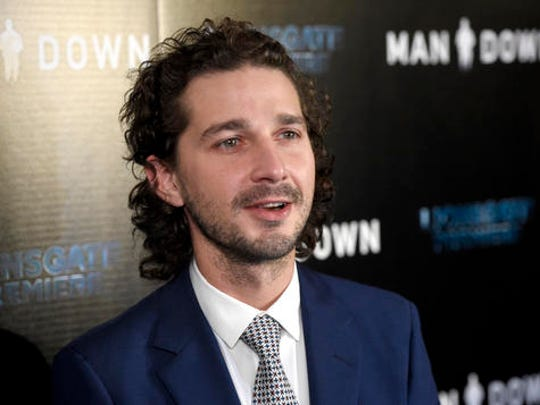 """FILE - In this Nov. 30, 2016 file photo, Shia LaBeouf arrives at the Los Angeles premiere of """"Man Down"""" at ArcLight Cinemas Hollywood. LaBeouf has been arrested early Thursday morning, Jan. 26, 2017, after he allegedly got into an altercation with another man outside a New York City museum. Police say LaBeouf pulled the scarf of an unidentified 25-year-old man early Thursday morning outside the Museum of the Moving Image in Queens, scratching his face in the process."""