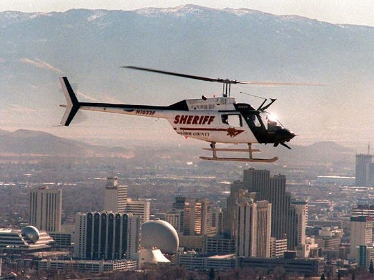 One of the Washoe County Sheriff's Office's RAVEN helicopters flies above Reno.