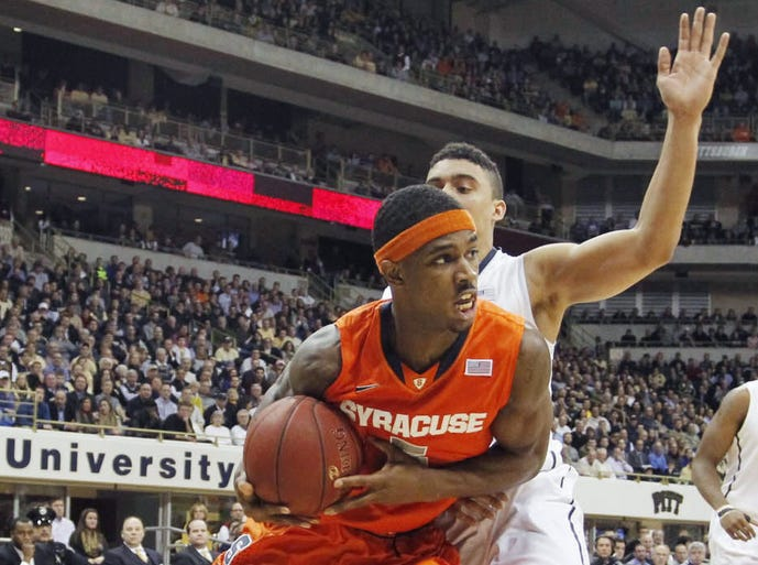 Syracuse Orange forward C.J. Fair (5) drives to the basket as Pittsburgh Panthers guard James Robinson (rear) defends during the first half at the Petersen Events Center.