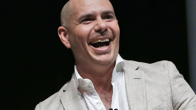 "FILE - In this April 19, 2016 file photo, Pitbull appears at the eMerge Americas technology event in Miami Beach, Fla. Pitbull released his $1 million contract with Florida's tourism marketing agency via Twitter Thursday, two days after the House speaker sued to find out details of the agreement that included the production of a video for the song ""Sexy Beaches."" House Speaker Richard Corcoran filed a lawsuit Tuesday in an attempt to have details of the contract disclosed. (AP Photo/Wilfredo Lee, File)"