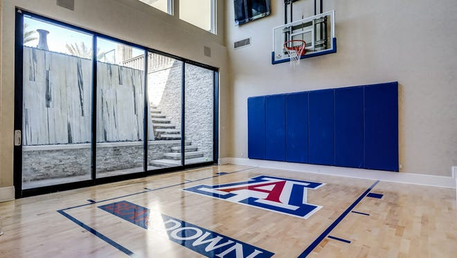 A mansion in Gilbert sold for $3.5 million, which is the second priciest home sale in the town's history. The inside of the home includes a basketball court with Arizona Wildcats' flavor.