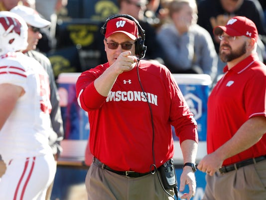FILE - In this Oct. 22, 2016, file photo, Wisconsin coach Paul Chryst gestures before the team's NCAA college football game against Iowa in Iowa City, Iowa. Wisconsin plays Florida Atlantic on Saturday, and Wisconsin is extending a helping hand to its next nonconference opponent. Florida Atlantic plans to arrive in Madison in time for the game Saturday against the Badgers, though the return trip is in question with Hurricane Irma potentially making landfall in south Florida this weekend. (AP Photo/Charlie Neibergall, File)