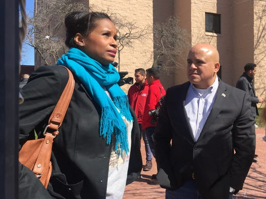 Nyeema Watson of Rutgers-Camden and Mayor Frank Moran stand outside the scene of a fire. Good Samaritans who may be university students came to the victims' aid, offcials said.